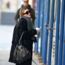 Ashley Olsen juggles her dog, some Starbucks and a cigarette as she sets out in New York City