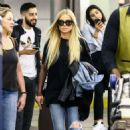 Carmen Electra in Jeans – Arrives at Airport in Miami