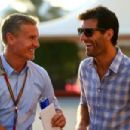 Mark Webber speaks with David Coulthard in the paddock before qualifying for the Abu Dhabi Formula One Grand Prix at Yas Marina Circuit on November 22, 2014 in Abu Dhabi, United Arab Emirates