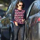 Mila Kunis – Wearing a Christmas sweater in LA