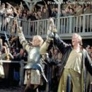 (From left to right) William (Heath Ledger) and Chaucer (Paul Bettany) celebrate one of the young knight's many victories on the tournament field in the Columbia Pictures presentation, A Knight's Tale - 2001