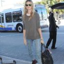 Behati Prinsloo dresses down for a flight ahead of Victoria's Secret Fashion Show... after spending Thanksgiving with Adam Levine