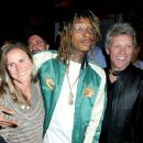 Former professional soccer player Brandi Chastain and recording artists Wiz Khalifa and Jon Bon Jovi attend the Fanatics Super Bowl Party on February 6, 2016 in San Francisco, California.