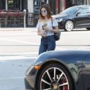 Actress and singer Lucy Hale stops by Starbucks in Los Angeles, California to pick up an iced coffee on August 24, 2016 - 454 x 600
