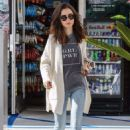 Lily Collins at a gas station in LA
