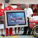 (L-R) Felipe Massa of Brazil and Ferrari, Ferrari Team Principal Stefano Domenicali, Fernando Alonso of Spain and Ferrari and Shell Downstream Director Mark Williams attend a presentation celebrating Shells 500th race in partnership with Ferrari before qu - 454 x 303