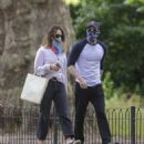 Lily James and Chris Evans – Seen eating ice cream on a date in the park in London - 454 x 529