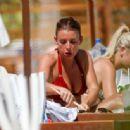 Coleen Rooney in Red Bikini on the beach in Ibiza - 454 x 336