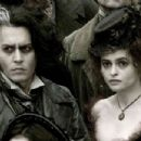 "The vengeful Sweeney Todd (Johnny Depp, left) and his willing accomplice Mrs. Lovett (Helena Bonham Carter, right) in ""Sweeney Todd: The Demon Barber of Fleet Street.""  Photo Credit: Leah Gallo. © 2007 by DreamWorks LLC and Warner Bros. Entert"