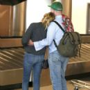 Kirsten Dunst with Jesse Plemons at LAX Airport in Los Angeles - 454 x 649