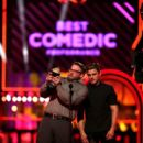 Zac Efron onstage during the 2016 MTV Movie Awards at Warner Bros. Studios on April 9, 2016 in Burbank, California - 400 x 600