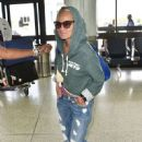 Kristin Chenoweth departing on a flight at LAX airport in Los Angeles, California on September 4, 2015 - 451 x 600