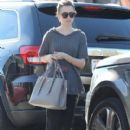 Lily Collins stops by a dry cleaners in West Hollywood, California on December 13, 2014