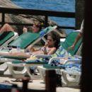 Selena Gomez relaxed poolside, February 4, in Rio de Janeiro
