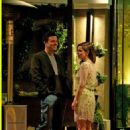 Seth MacFarlane and Emilia Clarke wait for their car outside the Four Seasons Hotel in Los Angeles after a dinner with friends, September 2012