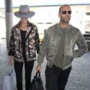 Model Rosie Huntington-Whiteley and her action star SO Jason Statham depart on a flight at LAX airport in Los Angeles, California on July 23, 2015