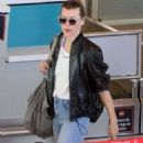Milla Jovovich at Cape Town International Airport in South Africa - 454 x 857