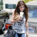 Selena Gomez was spotted getting out of her car with an iced drink from Starbucks today, July 3, in Los Angeles