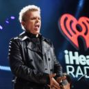 Recording artist Billy Idol performs onstage during the first ever iHeart80s Party at The Forum on February 20, 2016 in Inglewood, California. - 399 x 600