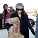 Eva Longoria prepares to depart LAX (Los Angeles International Airport) with a large pillow