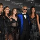 Man of the hour: The beauties also posed beside operatic legend Andrea Bocelli, who performed at the star-studded bash - 454 x 289