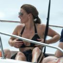 Coleen Rooney in Black Bikini at a beach in Barbados - 454 x 499