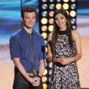 Chris Colfer (L) and Victoria Justice speak onstage during the 2012 Teen Choice Awards at Gibson Amphitheatre on July 22, 2012 in Universal City, California