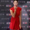 Red-dy to mingle! Newly-single Irina Shayk showcases her enviable model legs in A-line dress as she attends lipstick launch