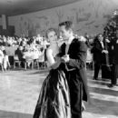 Joanne Woodward dances with husband Paul Newman following her Oscar win for best actress in 1957's