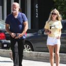 Kelsey Grammer and his wife stop by the Andy LeCompte Salon in West Hollywood, California on September 29, 2015 - 454 x 538