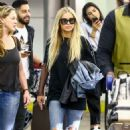 Carmen Electra in Jeans – Arrives at Airport in Miami - 454 x 715