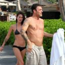 Megan Fox and  Brian Austin Green in Hawaii on Saturday afternoon (December 18).