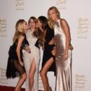 (L-R) Poppy Delevingne, Model of the Year Cara Delevingne, Joan Smalls and Karlie Kloss pose in the winners room at the British Fashion Awards at London Coliseum on December 1, 2014 in London, England