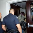 Selena Gomez gets a police escort as she prepares to depart LAX (Los Angeles International Airport) 4/30/2013 - 454 x 318