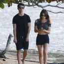 Joseph Jonas showed off what appeared to be newly shaved legs matching his sexy girlfriend Blanda Eggenschwiler strolling on the beach in Oahu, Hawaii on January 6, 2014
