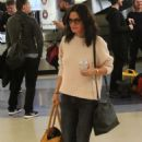 Courteney Cox and fiancee Johnny McDaid at LAX Airport in LA