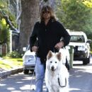 Billy Ray Cyrus takes his dogs out for a relaxing stroll through his neighborhood in Toluca Lake, California on April 4, 2014 - 442 x 594