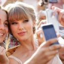 Taylor Swift poses for photos with fans as she arrives at the 26th Annual ARIA Awards 2012 at the Sydney Entertainment Centre on November 29, 2012 in Sydney, Australia