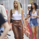 Sofia Richie – Wearing a white tank top and snake leather pants in New York City