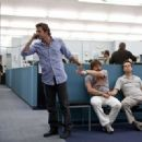 (L-r) Phil (BRADLEY COOPER), Alan (ZACH GALIFIANAKIS) and Stu (ED HELMS) are joined at the wrist by handcuffs at the police station in Warner Bros. Pictures' and Legendary Pictures' comedy 'The Hangover,' a Warner Bros. Pictures release. P