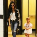 Kourtney Kardashian is spotted at an office building in Beverly Hills, California with her daughter Penelope on September 18, 2015