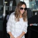 Jessica Alba touches down at LAX airport on August 26, 2016