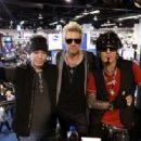 DJ Ashba, James Michael and Nikki Sixx attend day 3 of the 2016 NAMM Show at the Anaheim Convention Center on January 23, 2016 in Anaheim, California. - 454 x 315