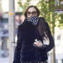 Famke Janssen – Wears gloves and a scarf while running errands in NYC