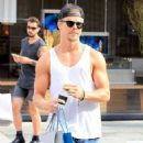 Derek Hough enjoys some solo shopping in Beverly Hills, California on September 9, 2015 - 454 x 586