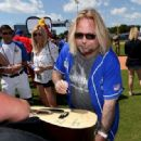 Vince Neil of Motley Crue arrives at the 27th Annual City of Hope Celebrity Softball Game at First Tennessee Park on June 10, 2017 in Nashville, Tennessee - 454 x 318