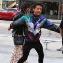 Jaden Smith puts his arms around Kylie Jenner and shows her an item while shopping together at Crystalarium on Tuesday (November 19) in West Hollywood, Calif - 454 x 600