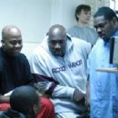 Director Damon Dash (seated, left) and Beanie Sigel (standing, far right) on the set of State Property 2. Photo credit: Dominick Conde