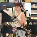 Lucy Hale – On a Gas Station in Los Angeles