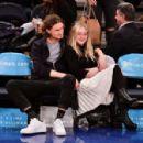 Dakota Fanning and Henry Frye at New York Knicks vs Milwaukee Bucks game in NYC